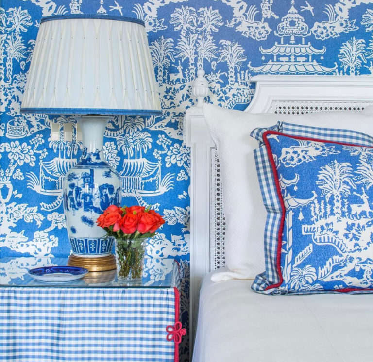 A blue and white bedroom scheme complete with custom lampshade and tableskirt trimmed with Samuel & Sons passementerie.