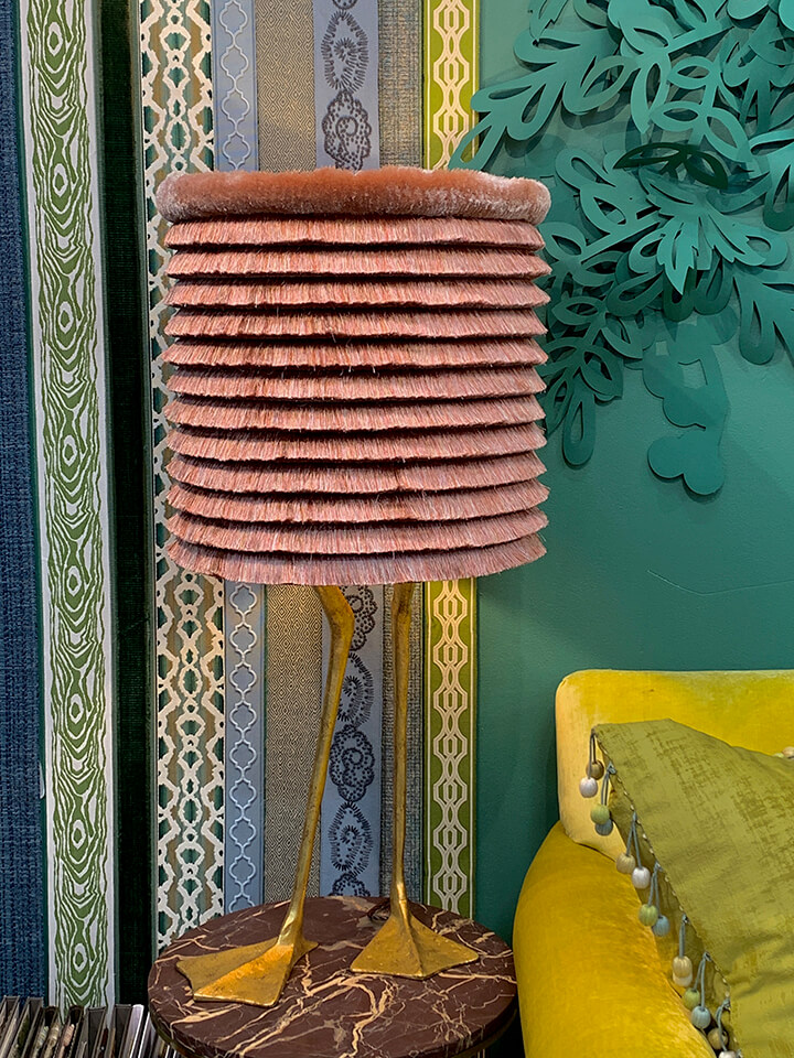 A playful, fringe wrapped lamp with gold duck feet.