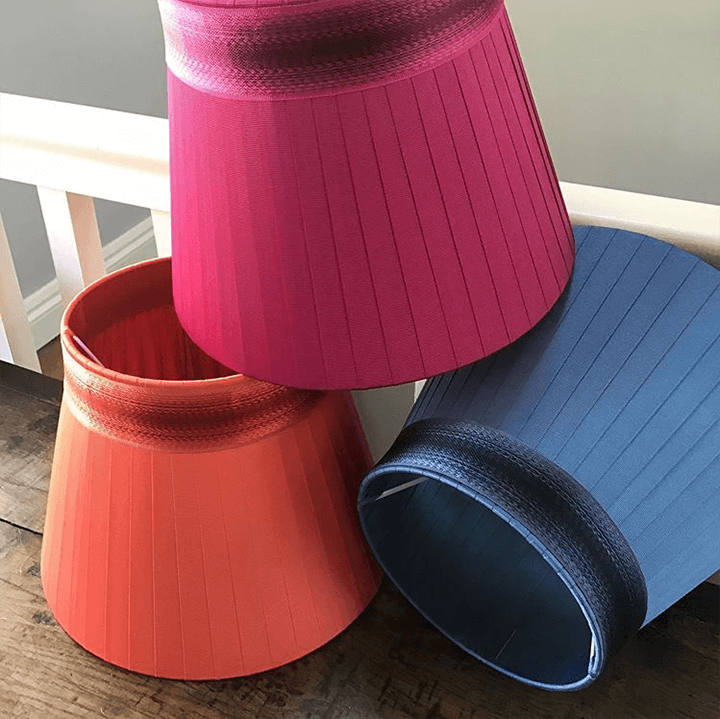 A stack of colorful mini lampshades