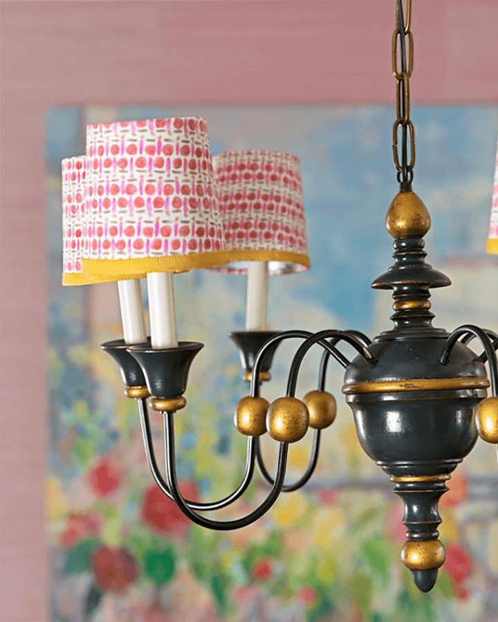A whimsical chandelier with miniature printed shades.