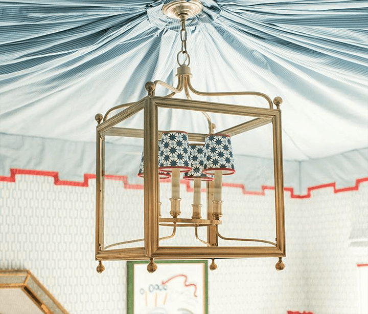 A modern chandelier with miniature printed lampshades.